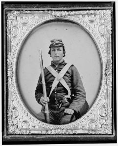 Image of Civil War soldier William H. Rockwell holding rifle